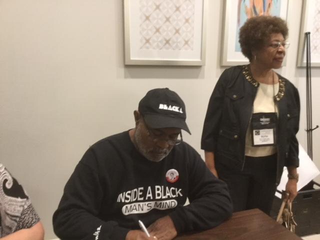R. Jones- getting autographed copy of The Black Klansman