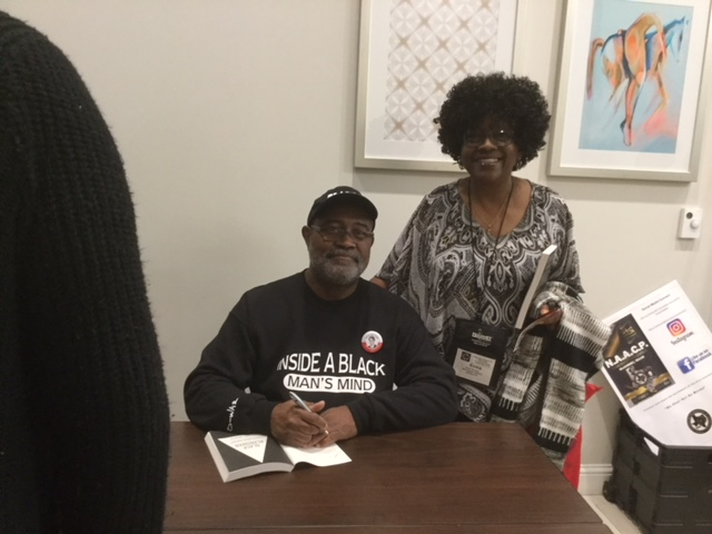 Mr. Stallworth with E. Brooks- giving autographed copy of The Black Klansman