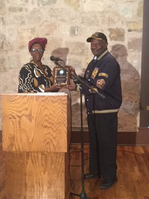 President Spears presenting plaque to artist, Burl Washington in appreciation of his expressions in art of the Buffalo Soldiers.